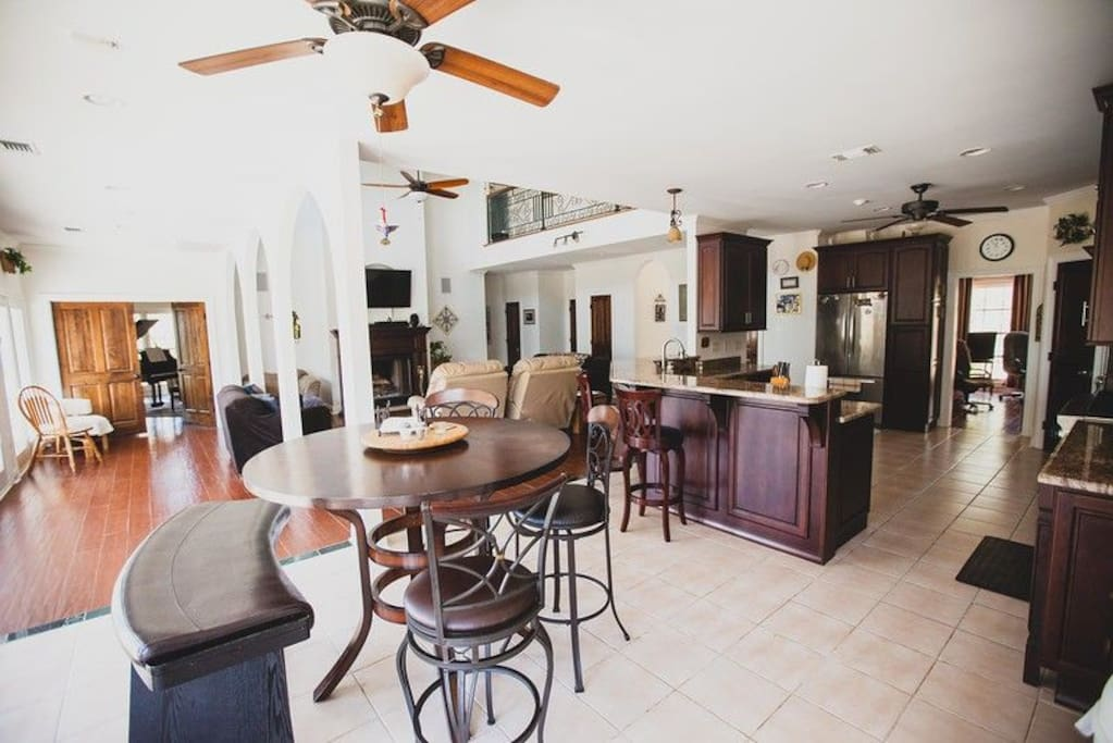 Spacious Gourmet Kitchen fully Equipped including spices, dishes, pots, and pans.