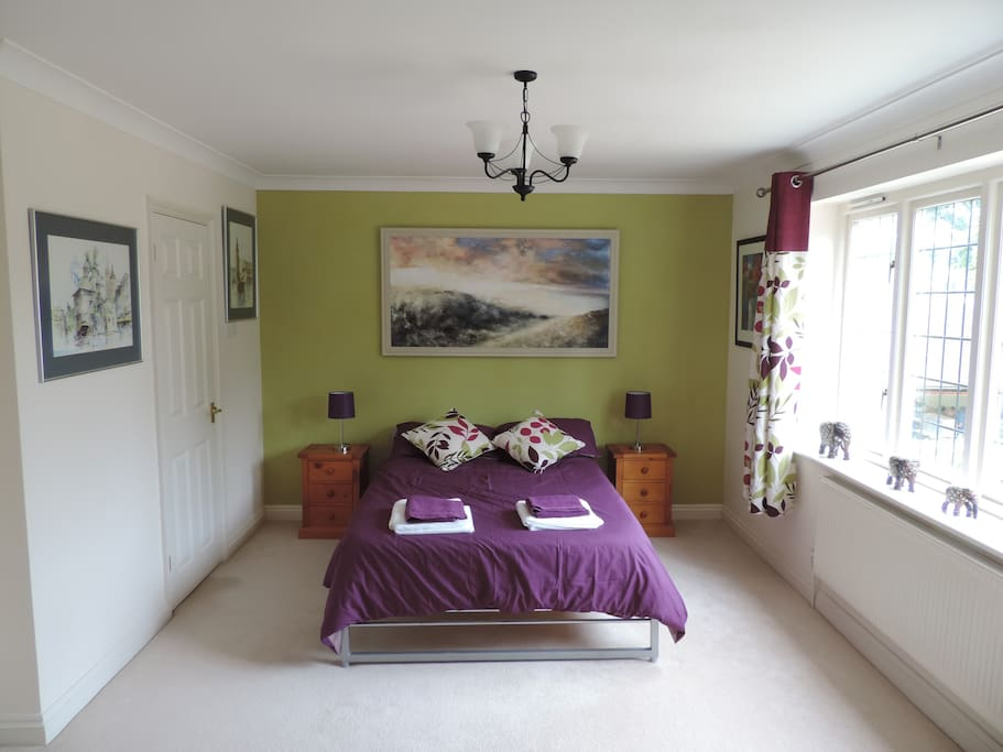 Large bedroom with double bed and  en suite shower room.