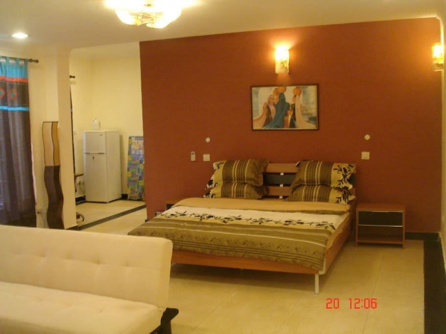 Large comfortable room with air conditioning, wifi, fridge, bathroom.