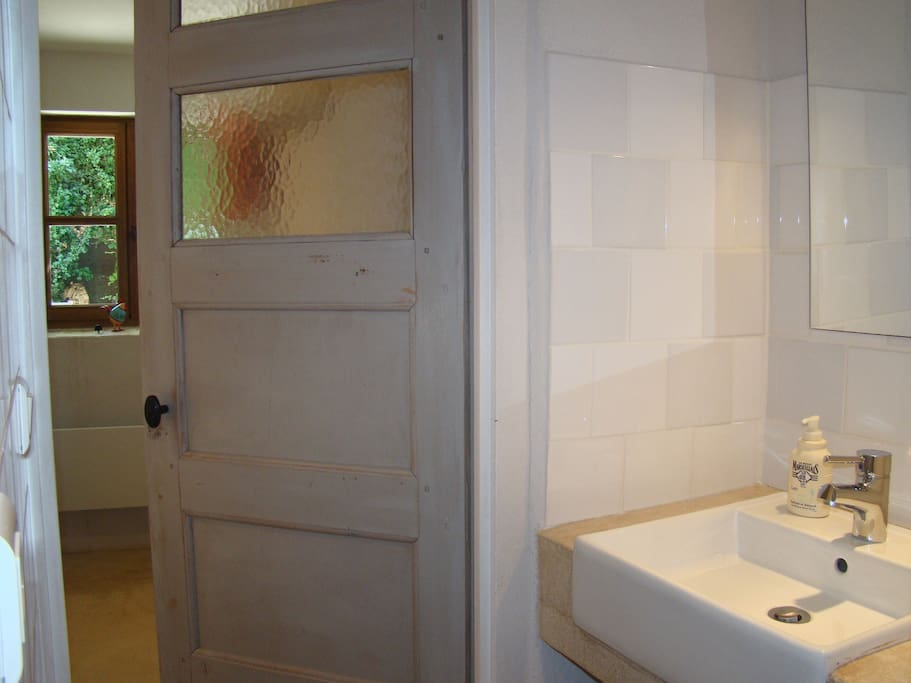 Bathroom with toilet, shower and washbasin