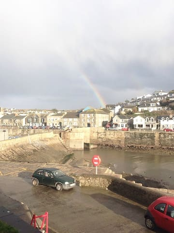 Rainbow over harbour porthleven