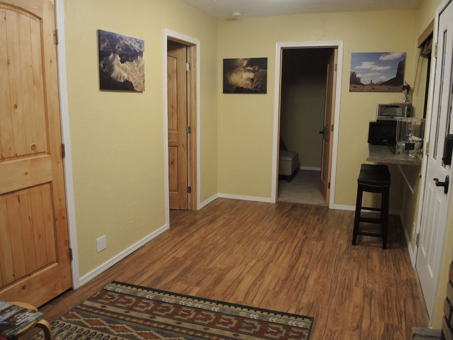 Living area connects to bedroom and bathroom, with displays of some of the nearby attractions you may be visiting.