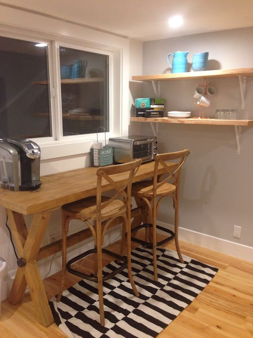 This shows the beautiful farm table with antique stools. We have provided a Keurig & toaster oven for your use. There is no kitchen but you will have access to our garage which has a washer & dryer & refrigerator for your use.