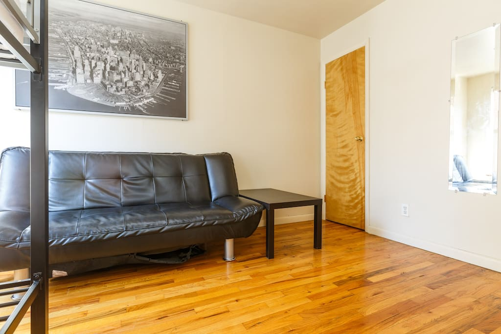 Furnished with beds, sofa, coffee table, nightstand, and a built in closet.