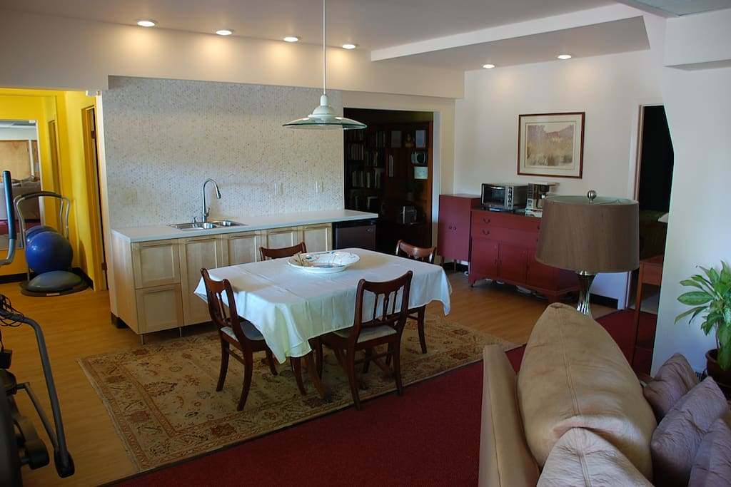 Kitchenette includes a sink, mini-refrigerator, microwave, toaster oven and coffee pot.
