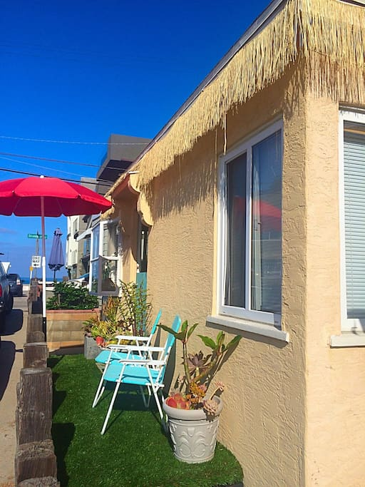 Relax, and kick back while looking out at the ocean.  Artificial turf patio, umbrella, and chairs.  It's ready for you.