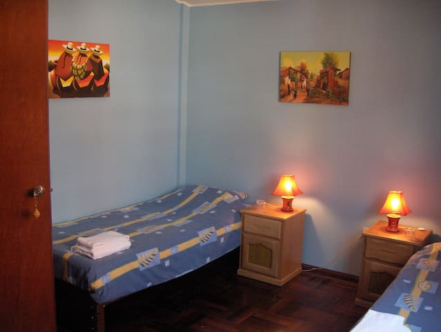 Room with share bathroom (only 1 other person) 1 double or 2 single beds
