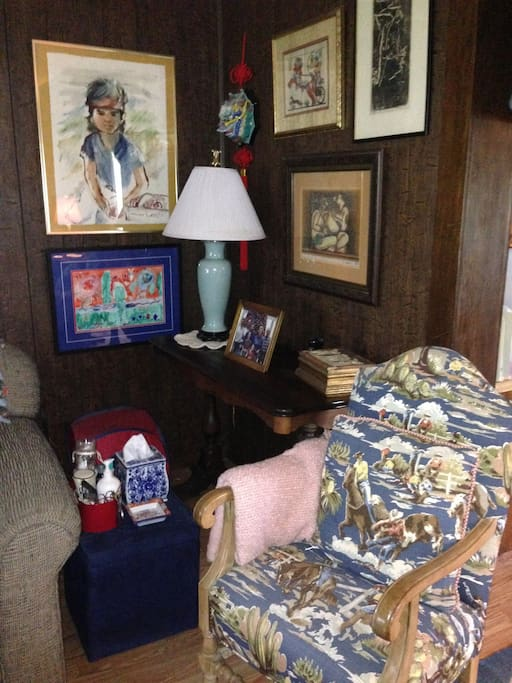 Art, antiques and photographs fill the house.