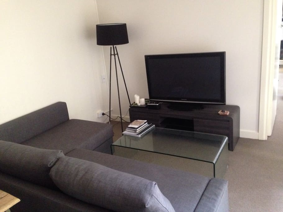 """Lounge room with 43"""" LG flat screen television, DVD's and Blu-Rays"""
