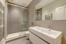 There is a large walk-in shower.