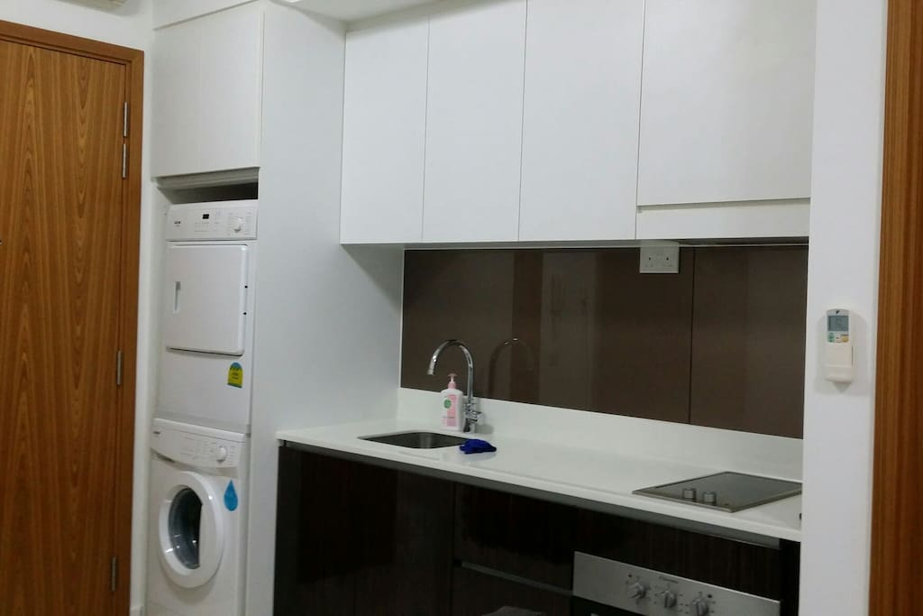 Kitchentte with electric stove and oven.. Washing machine n dryer provided
