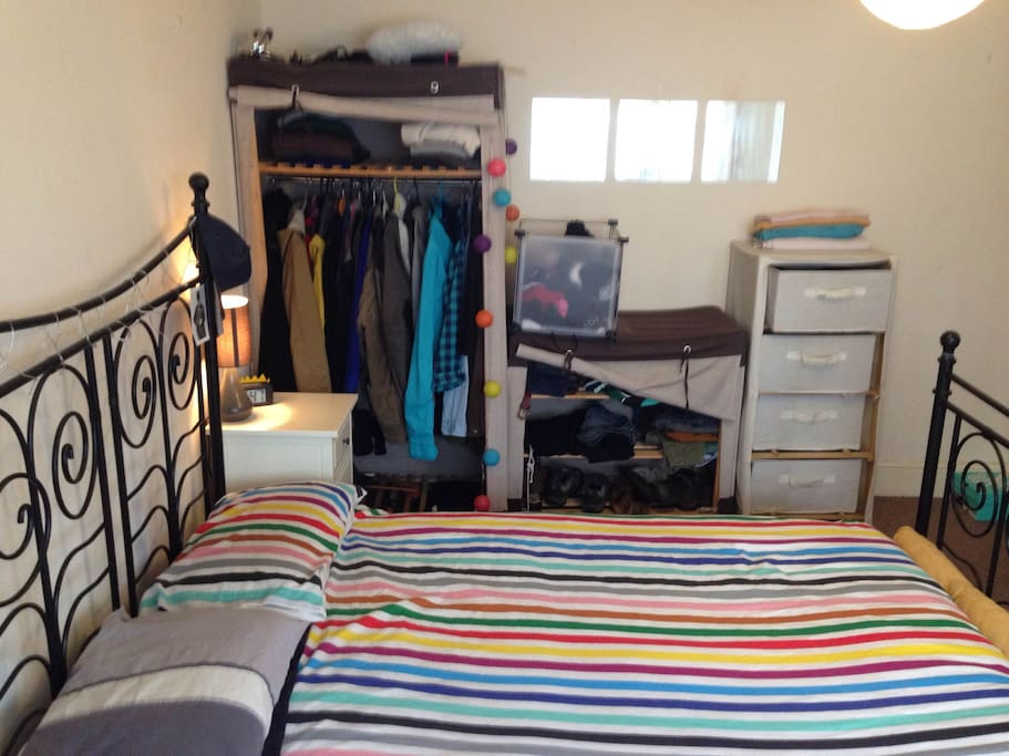 Master room. features wardrobes, chest of drawers, bed tables and lighting.