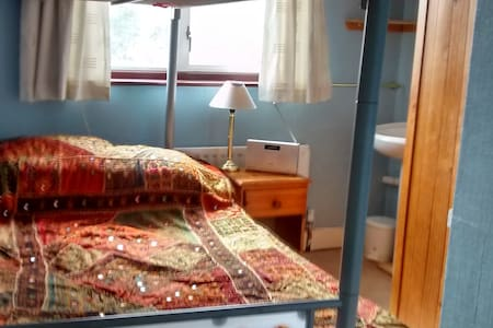 Small room with wash-basin and double bunk-bed. - Bed & Breakfast