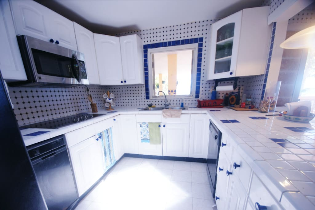 Fully equipped and bright kitchen.