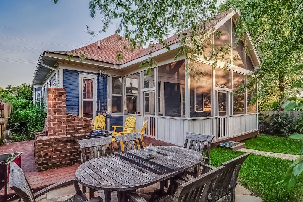 Outside dining and AMAZING screened in...