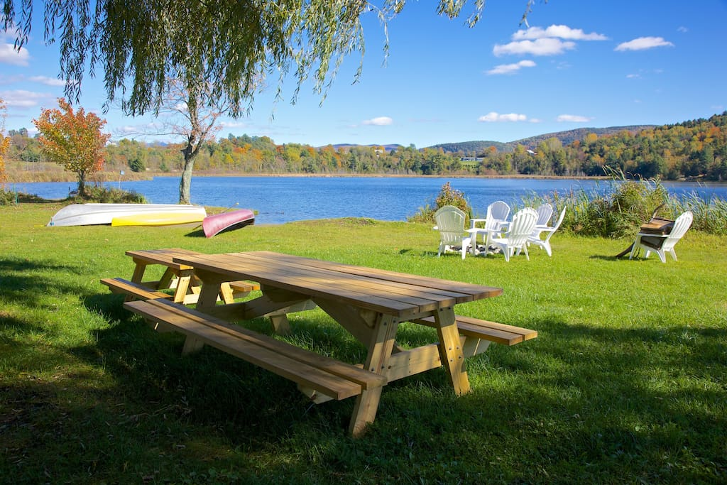 Large and kid sized picnic table over looking Cedar Lake in autumn.