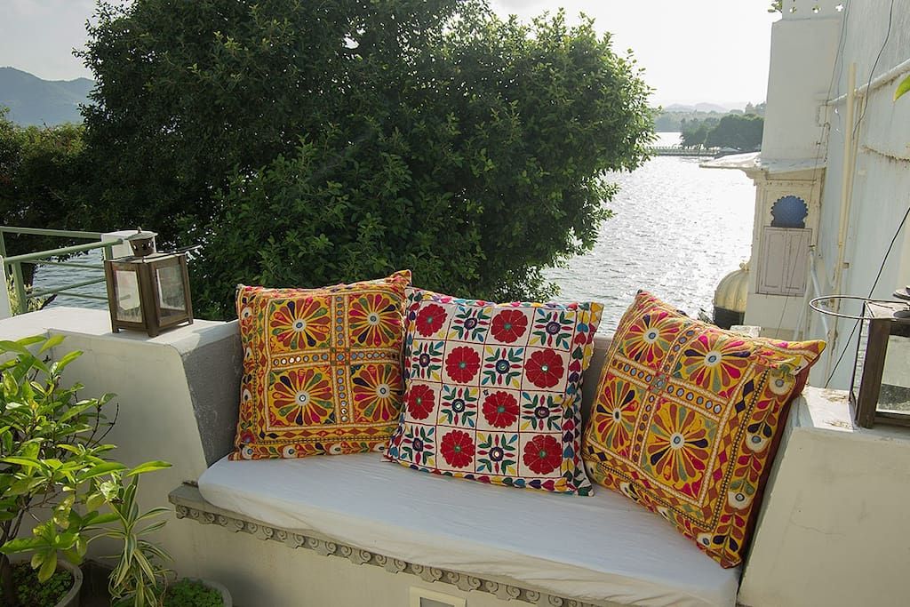 Cosy cushions and lake gazing.