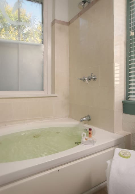 Large whirlpool tub with shower.