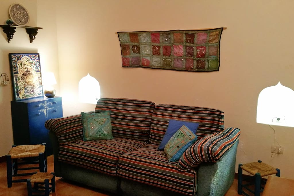 The colorful sofa bed and the Mediterranean inspired items