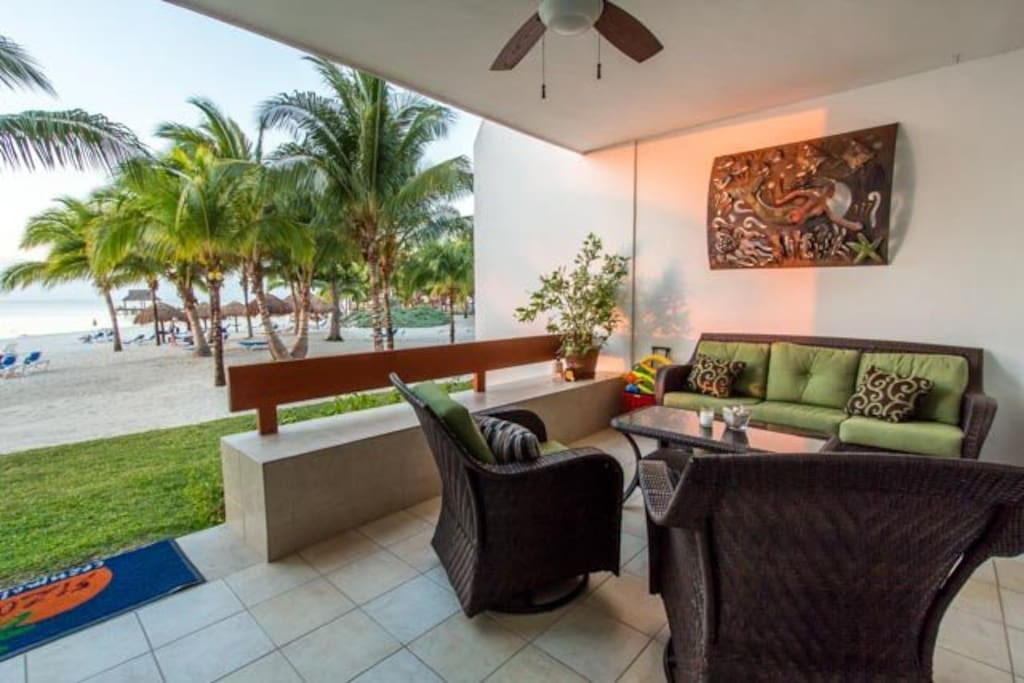 The terrace has comfortable seating and direct beach access