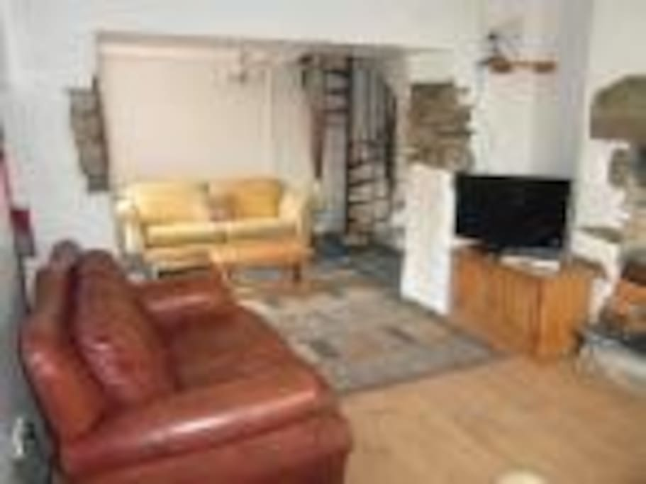 Large lounge with wood burner for cosy evenings in.