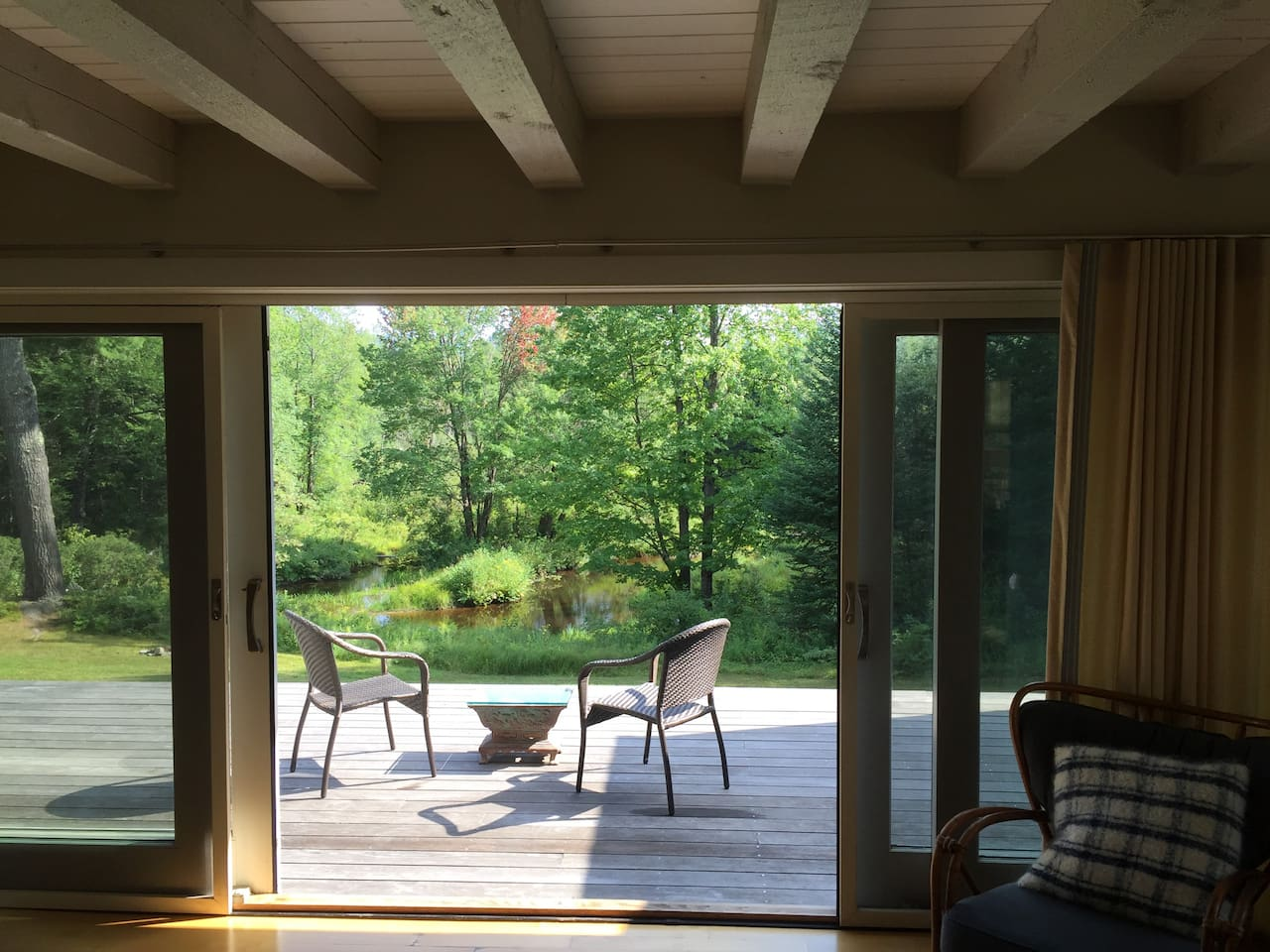 Sliding doors to deck off main floor living space — your own private picture of nature.