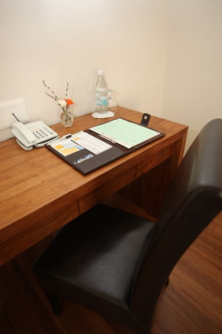 a small desk area in each room