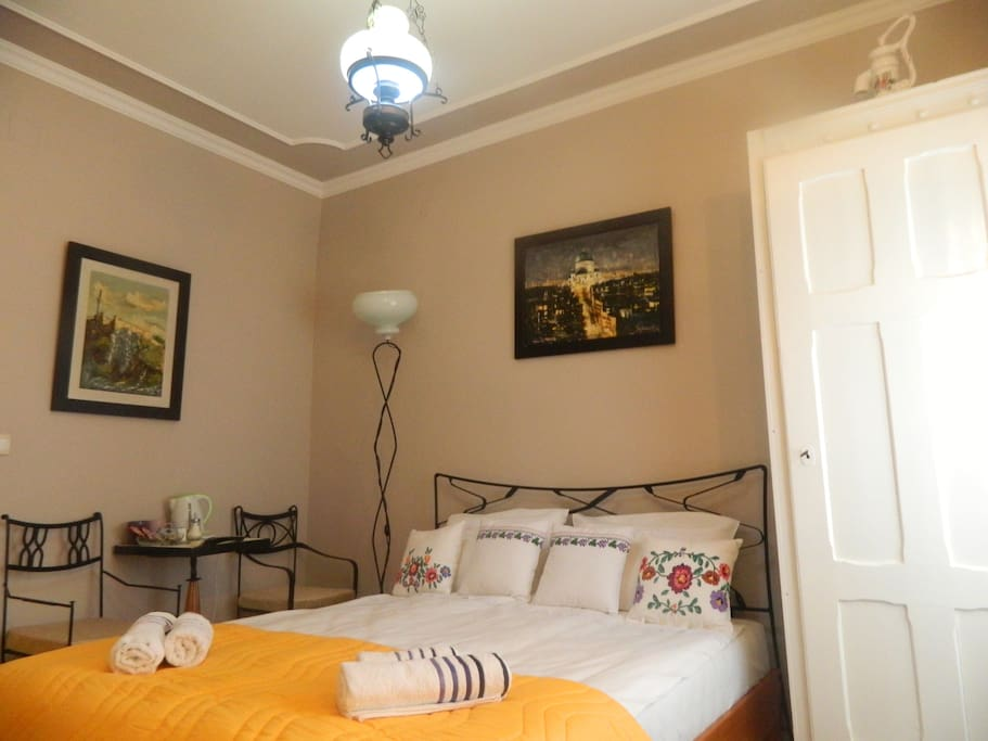 Our suite for two persons with wooden and wrought iron bed