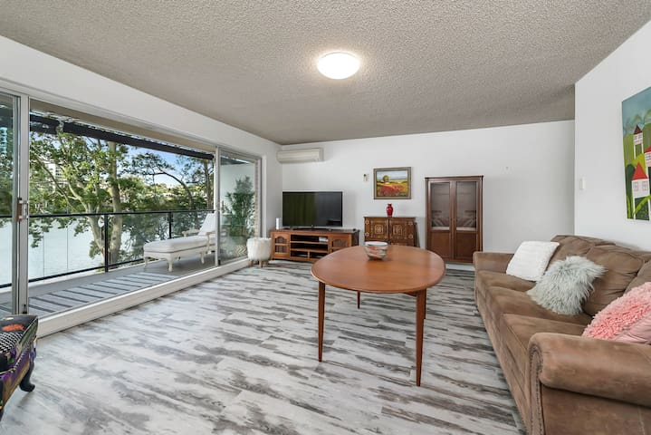 Spacious, with river view, right by University.