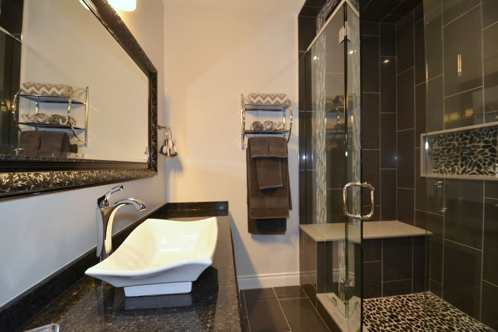 Spa-like glass shower with bench
