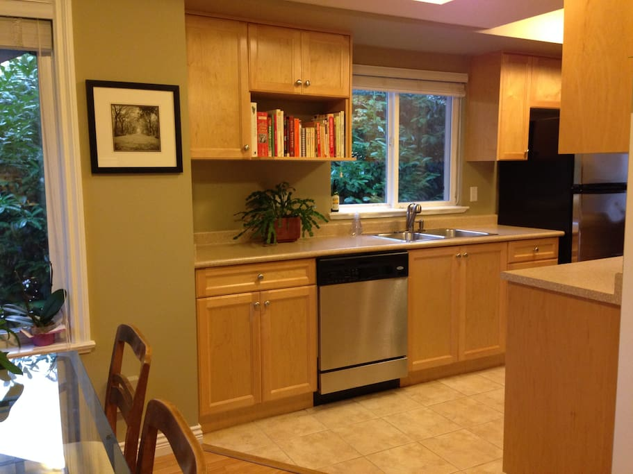 Full kitchen, with dishwasher, fridge, cabinet freezer, stove, oven, and microwave.