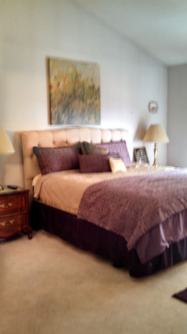 Large master bedroom suite with king sized, pillow top mattress.  Looks out over treed corner lot and back deck.  Sunny and fresh with blackout shades for privacy and late morning slumber.