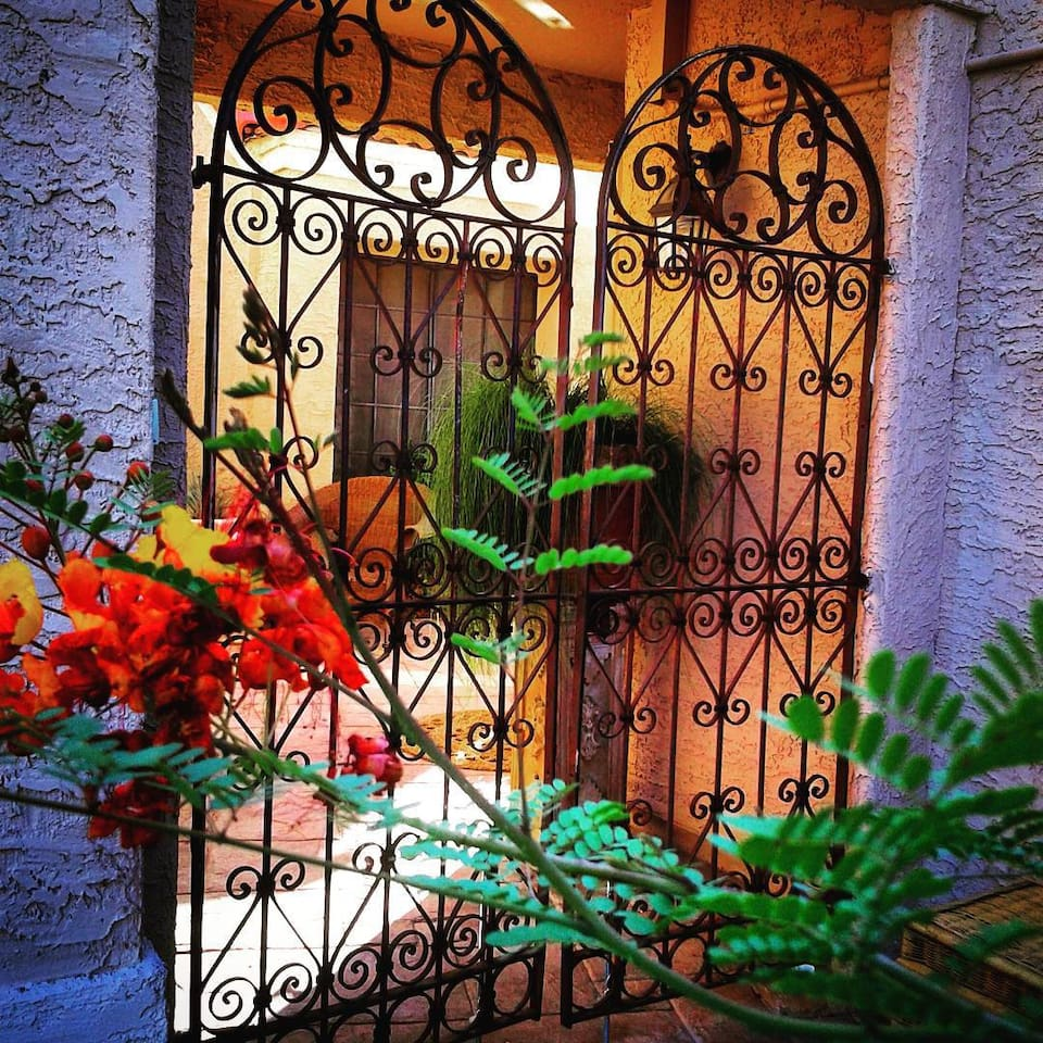 Iron gates that lead into the courtyard.