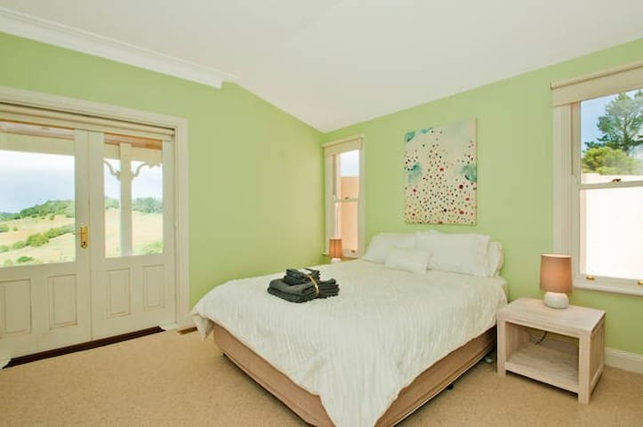 Queen bedroom 2 is a spacious bedroom situated in the northern wing of the house.  It has french doors that open out onto a private verandah and offers a comfortable queen bed, built-ins and an ensuite.  All fresh linen supplied.
