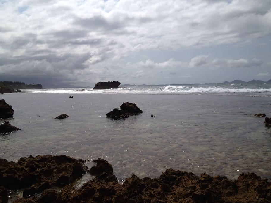 Your private beach overlooks a vibrant reef to just chill and enjoy, or to explore. For surfers, probably the most consistent right point break in the country, known as Monseignors, is just adjacent to the boulder in the background.