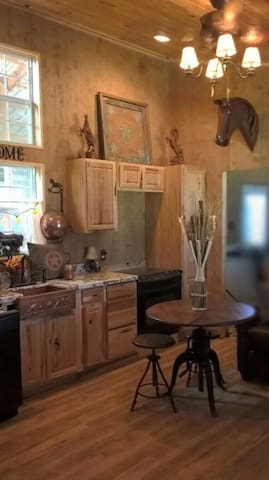 Full kitchen with all full size appliances, granite and copper
