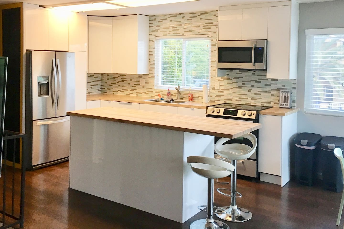 Upstairs: Large, light, bright remodeled kitchen. Kitchen has 10' long butcher block island with 2 barstool seats. There is an oven, microwave, refrigerator, dishwasher, and Keurig coffee maker. A cook's dream!!