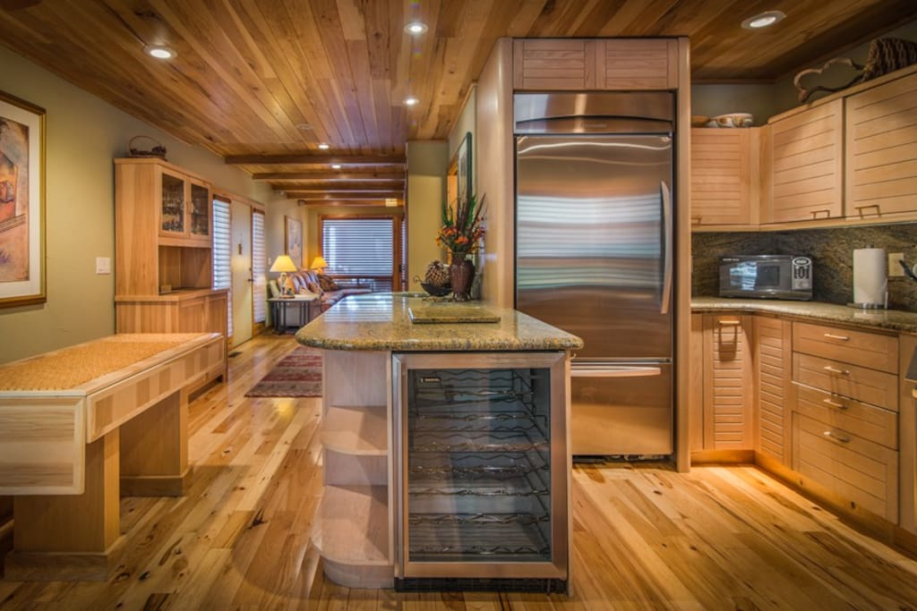 Gourmet kitchen- entertain in style.  Custom crafted modular tables can seat up to 16 people without taking up much space!
