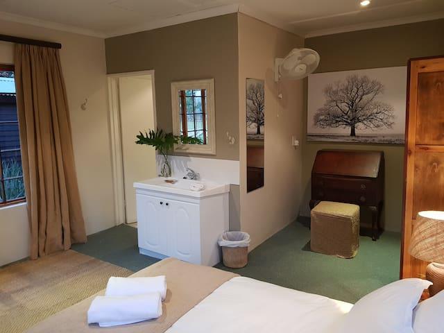 En-suite shower and loo. Large basin in room.