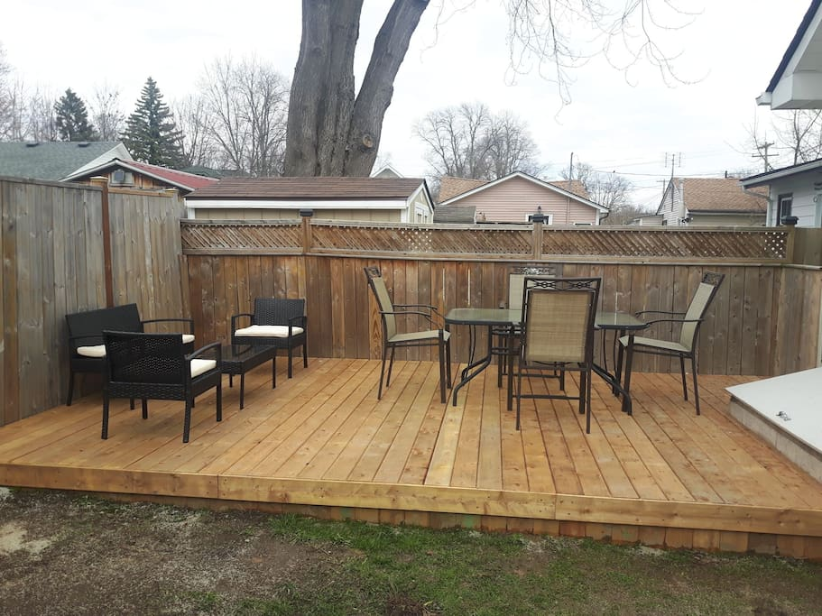 New spacious deck with dining and seating area.