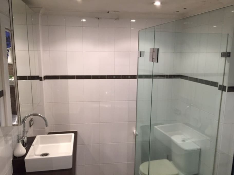 Bathroom which has shower and separate bath