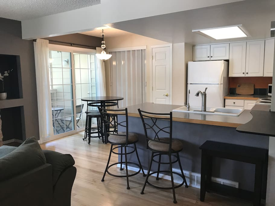 Dining area, kitchen, and a stand up or sit down (counter height) adjustable laptop desk.