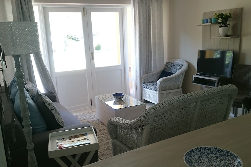The lounge is open plan with the kitchen offering plenty of comfortable seating and doors opening on to the patio