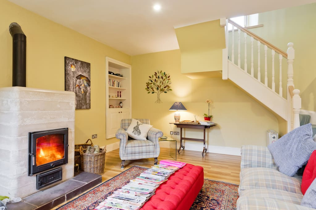 Spacious, light and airy living room with French window opening out to the Orchard. Ceramic wood burning stove.Dining table that can seat 8 with access to a small fitted kitchen.