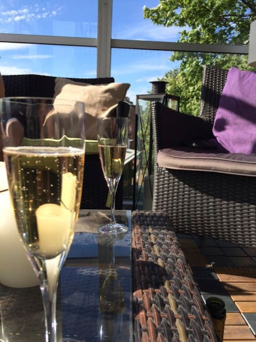 Enjoy the complimentary champagne on the big balcony