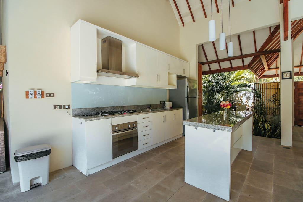 Enjoy the well-equipped kitchen in open plan with the dining room.