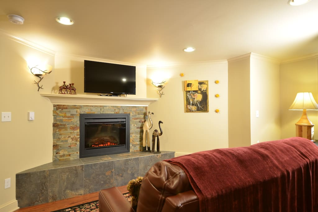 Sitting area with fireplace and 39 inch flat screen TV.