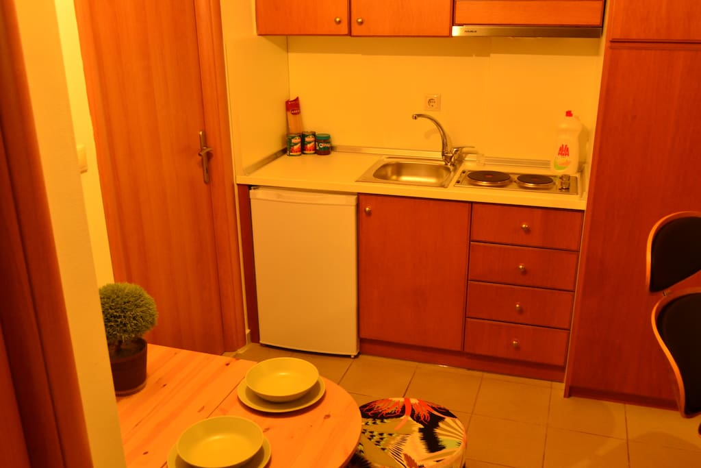Kitchen with Fridge, and fully equipped.