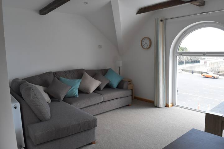 Open plan lounge enjoying view of Laxey Beach, quiet harbour, piers and Irish Sea.  Sofa converts to luxury double sofa bed, with extra thick mattress for comfort.