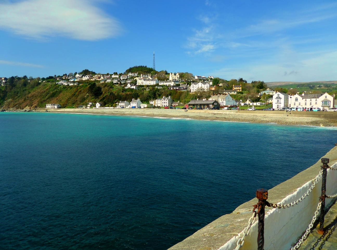 Beautiful Laxey Beach.  The apartment is situated in the cream property on the right hand side, third floor.